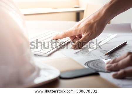 Top view of architect drawing on architectural project,Projecting with pencil on the urban drawings. home planning,Architectural plans. - stock photo