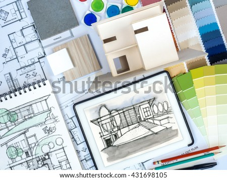 Top View Of Architect, Interior Designer Worktable With Home Model, Tablet  Computer, Sketch