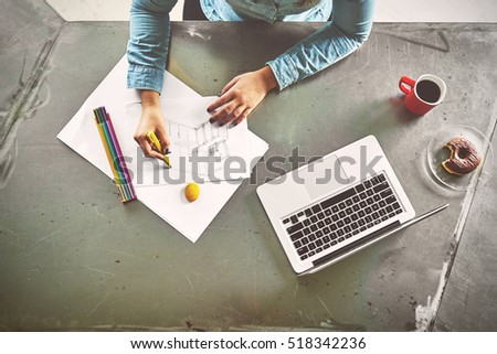 Top view of architect woman sketching a kitchen in office