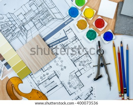 Top view of artistic worktable with  sketch, sample & blue print/ Real estate business conceptual