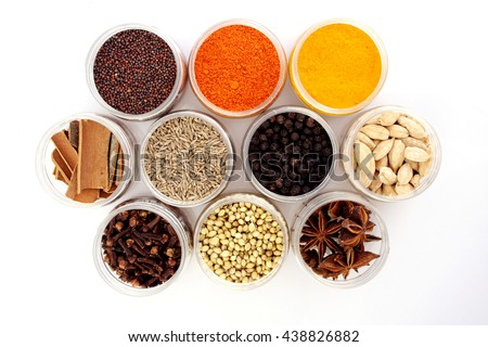 Top view of assorted spices on white background - stock photo