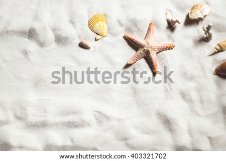 Top view of Beach sand with shells and starfish summer concept.vintage tone. - stock photo