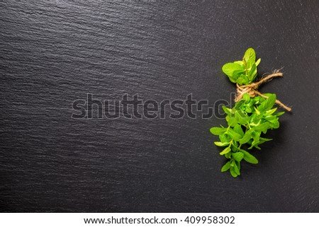 top view of beautiful bunch fresh green mint on slate background - stock photo