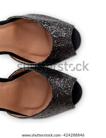Top view of black glitter sandals cropped. Object is isolated on white background and has soft shadow and clipping path. - stock photo
