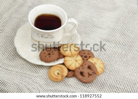 Top view of black tea cup with yummy biscuits