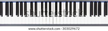 Top view of blank piano keys - stock photo