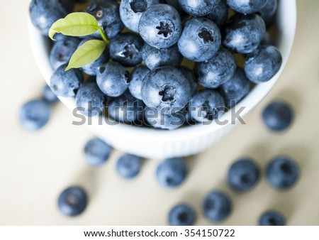 Top view of blue berries in white blow - stock photo