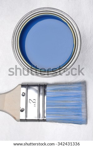 Top view of blue paint can with brush on grey metal background - stock photo