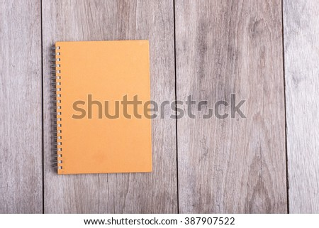 Top view of book on old wooden plank background