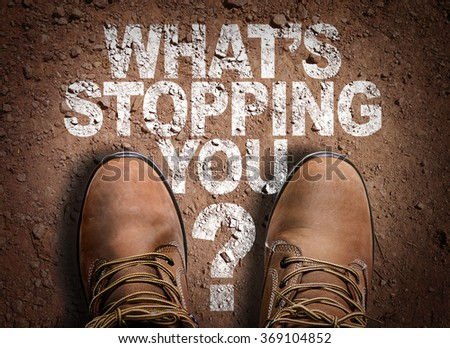 Top View of Boot on the trail with the text: Whats Stopping You? - stock photo
