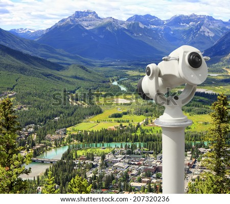 Top view of Bow river valley and Banff city with telescope (Banff National Park. Alberta. Canada)  - stock photo