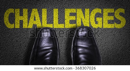Top View of Business Shoes on the floor with the text: Challenges - stock photo