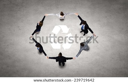 Top view of business team making recycling figure - stock photo