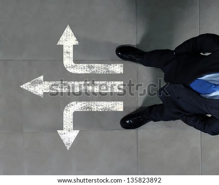 Top view of businessman standing against directions background - stock photo