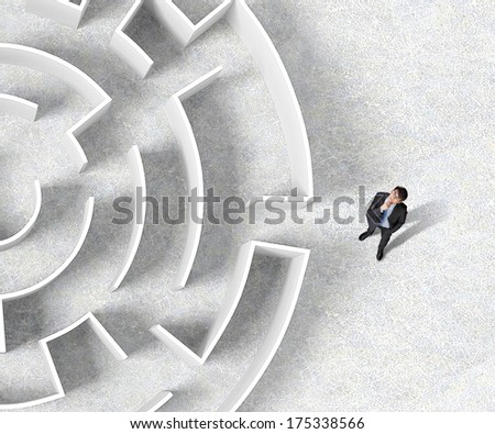 Top view of businessman standing near the enter of labyrinth - stock photo
