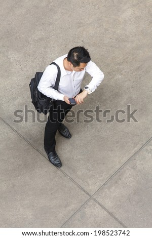 Top view of businessman using smart phone