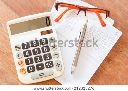 Top view of calculator, pen, eyeglasses and bank account passbook, stock photo - stock photo