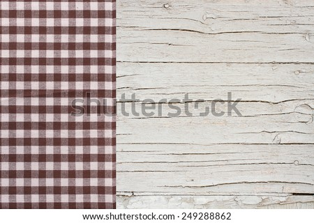 Top view of checkered napkin tablecloth on white wooden table. Unique perspectives - stock photo