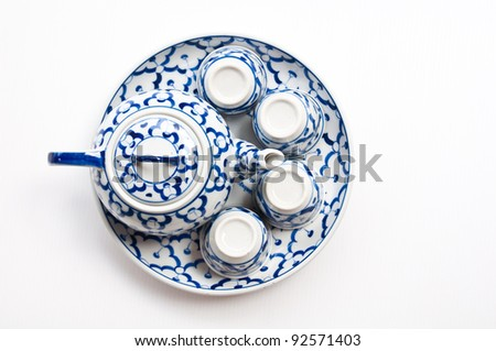 top view of chinese tea pot and cups isolated on white background