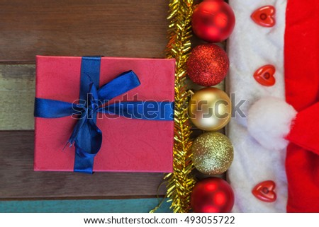 Top view of Christmas ball and pine tree with decoration on wooden floor