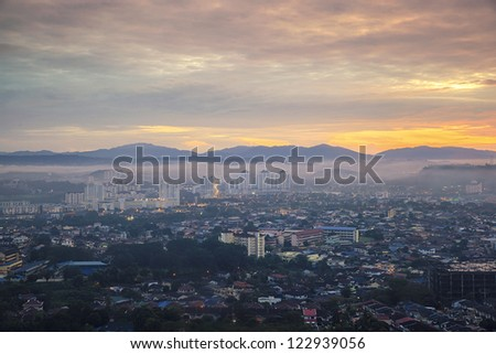 Top view of city, sunrise - stock photo