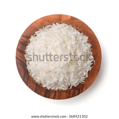Top view of coconut shavings bowl isolated on white - stock photo