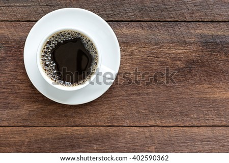 top view of coffee cup on wooden background - stock photo