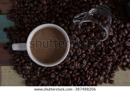 Top view of coffee cup with beans background - stock photo