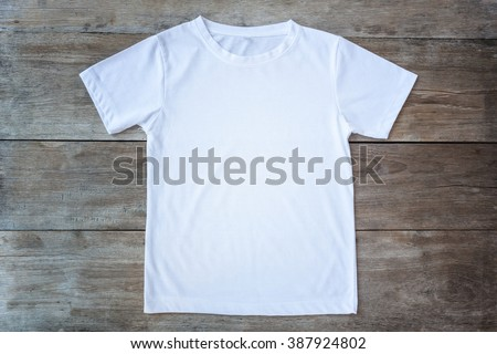 Top view of color T-Shirt on grey wood plank background - stock photo