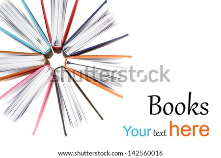 Top view of colorful books in a circle isolated on white background - stock photo