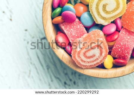top view of colorful candy on old table - stock photo