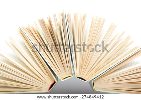 Top view of colorful hardback books in a circle. Open book, fanned pages. Back to school copy space. Education background.