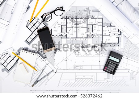 Top view construction plans tablet drawing stock photo for Blueprint estimator