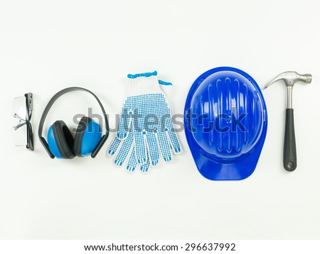 top view of construction tools and protective equipment aligned in a row, on white background - stock photo