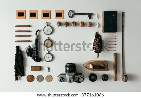 Top view of creative arrangement of vintage travel things on desk - stock photo