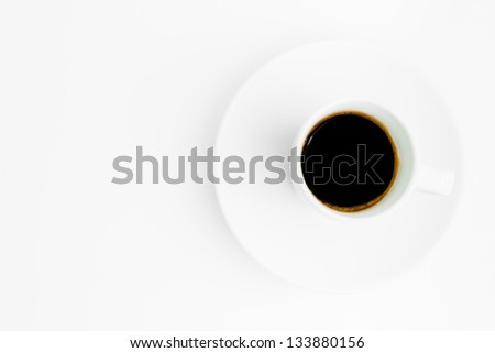 top view of cup of black coffee with space for text over the white background