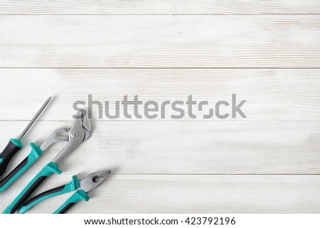 Top view of different type of constructive tools placed in a row with copy space. Construction instruments and tools. Set of tools. Home tool kit. Everyday instruments. Work stuff. Mend and repair.  - stock photo