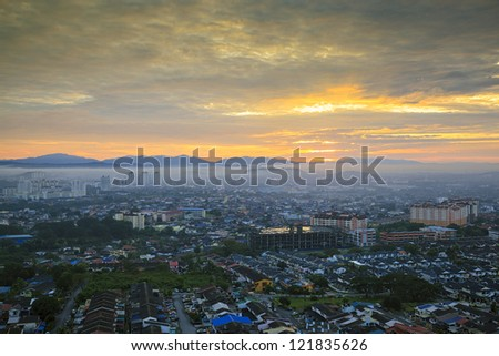 Top view of downtown at sunrise - stock photo