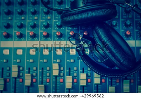 Top view of Earphone on mixer, music instrument concept - stock photo