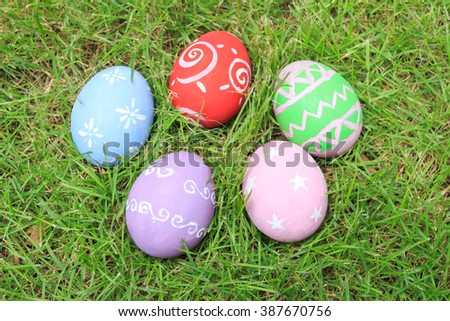 Top view of easter eggs on green grass.