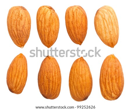 Top view of eight almond nuts isolated on white background - stock photo