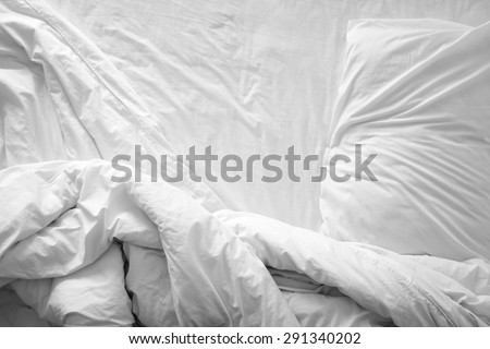Top view of f bedding sheets and pillow - stock photo