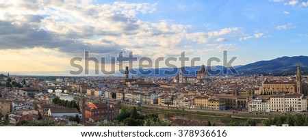 Top view of Florence city with arno river bridges and historical buildings, on cloudy sunrise or sunset sky background.