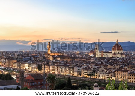 Top view of Florence city with old and historical buildings, on cloudy sunrise or sunset sky background.