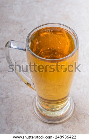 top view of glass of beer on stone background - stock photo