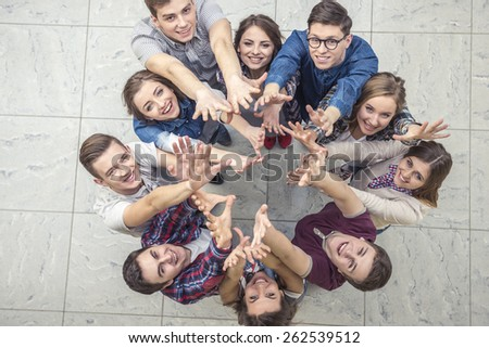 Top view of group of people. Standing together, raising their hands up. - stock photo
