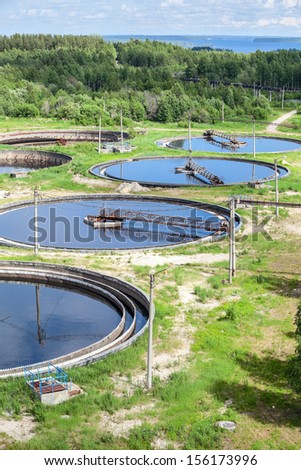 Top view of group of primary circular sedimentation tanks for sewage cleaning - stock photo