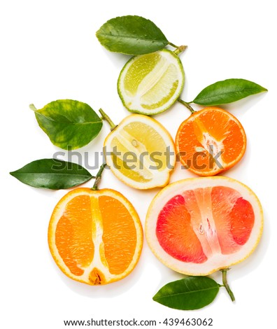 Top view of halves citrus fruits (orange, lime, grapefruit, clementine and lemon) with green leaves isolated on white background. - stock photo