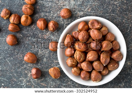 top view of hazelnuts in bowl - stock photo