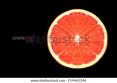 Top view of Healthy fresh grapefruit slice. Template design isolated on black with sample text. Healthy diet concept - stock photo